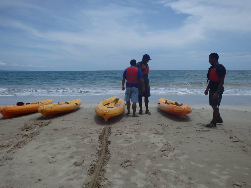 Preparing sea kayaks for launch in Costa Rica