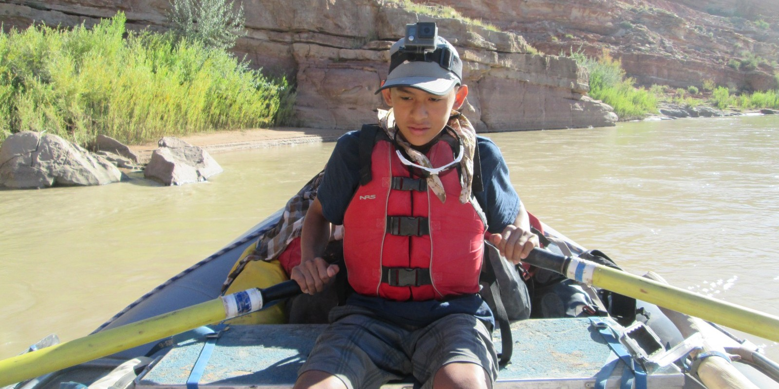 Teen wilderness camp river trip in Utah canyons
