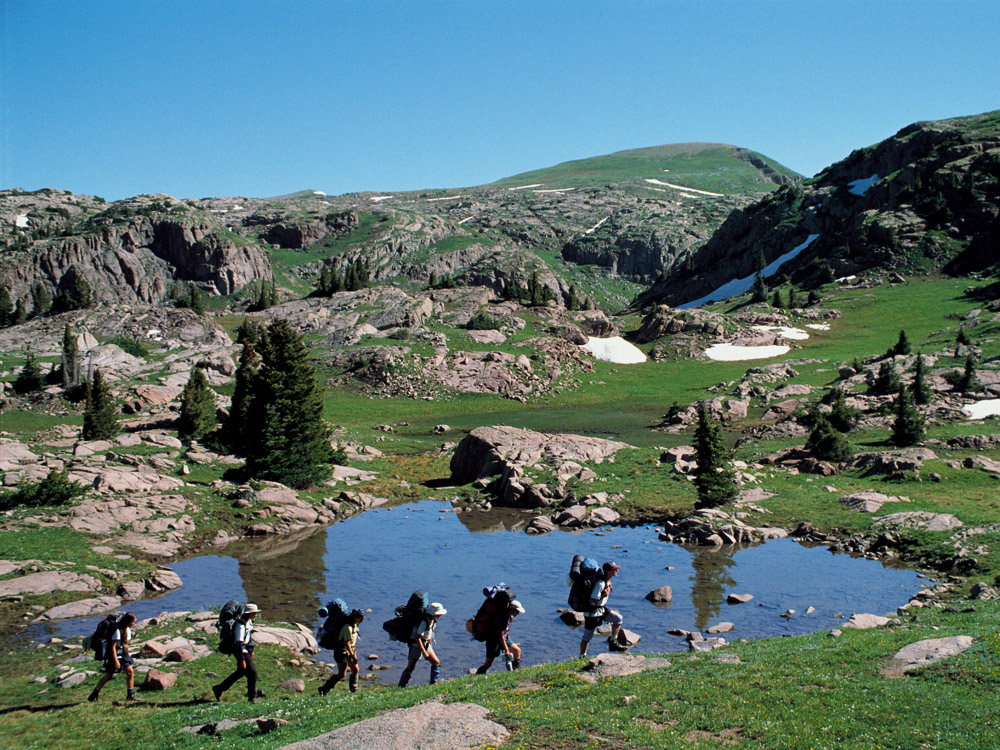 Group hiking through alpine tundra