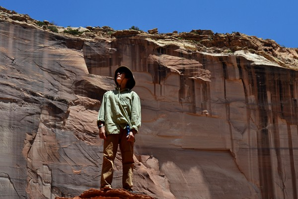 Boy and canyon wall 1000x500