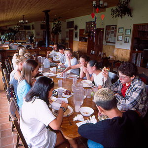 Participants eating in the dining hall at the House