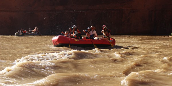 A group paddles out one of the lesser rapids