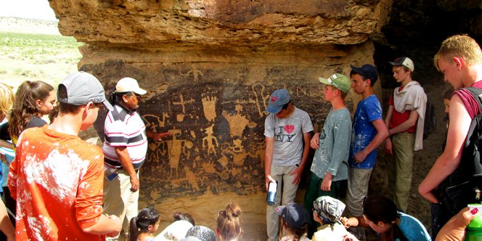 Zuni tourguide discussing Anasazi Petroglyphs
