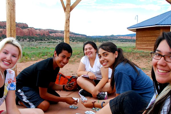 A group relaxing at their service site in Navajo Nation