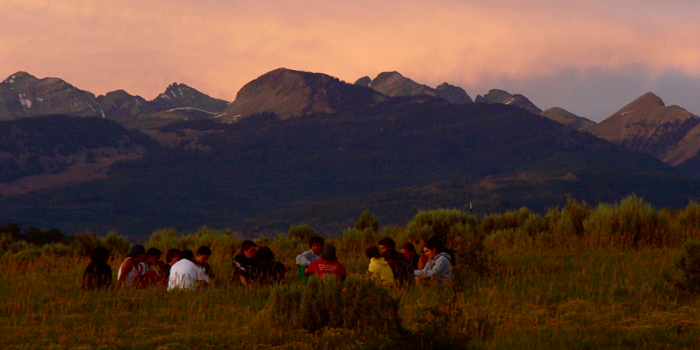Group holding 'Circle' on a mountain pass