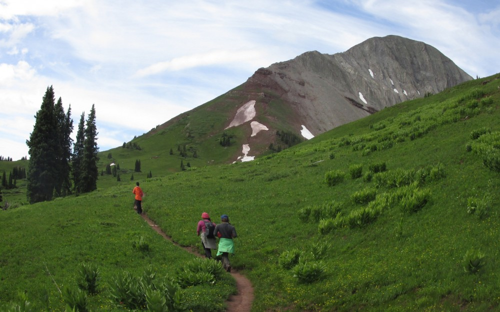Teens backpacking at summer wilderness camp