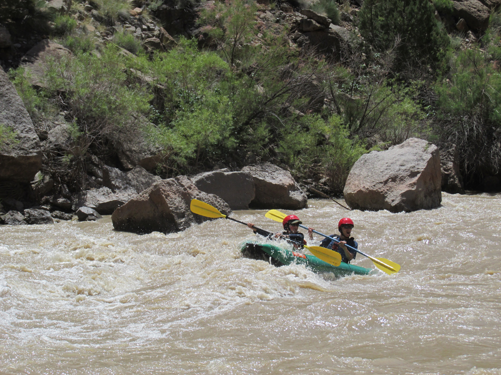 Participants take on a rapid in their wilderness adventure in the southwest
