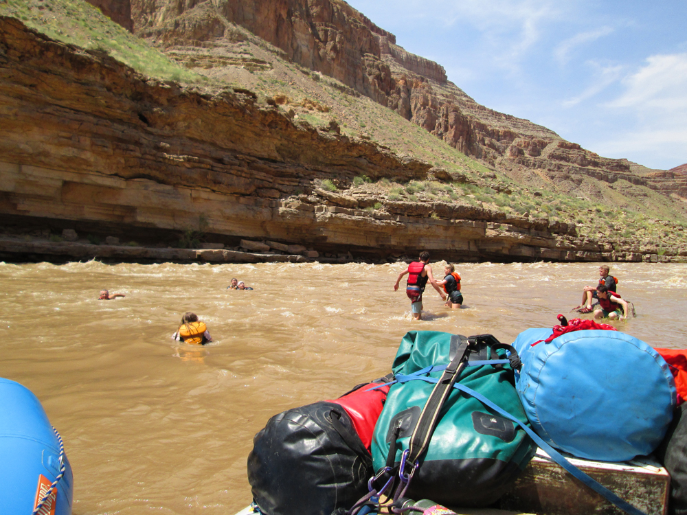 Time for fun in on their wilderness adventure, a group plays in the San Juan River